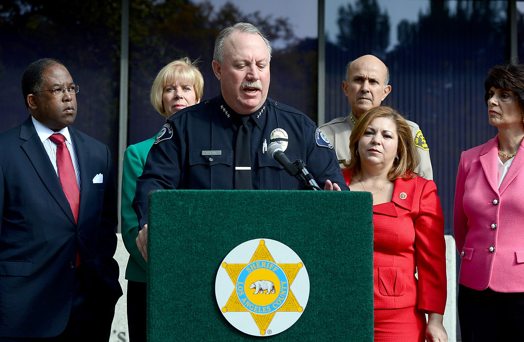 . Montebello Police Chief Kevin McClure speaks to the press in support of Congresswoman Linda Sanchez\' legislation to assist law enforcement with gun buyback programs Thursday, February 21, 2013 at Los Angeles County Sheriff\'s Headquarters. (SGVN/Staff Photo by Sarah Reingewirtz)
