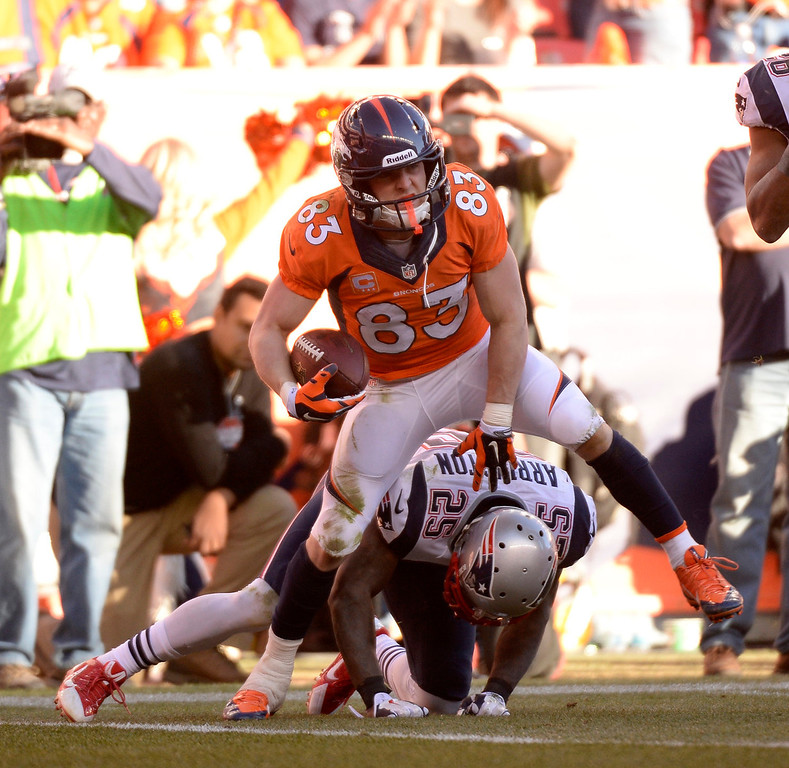 . Denver Broncos wide receiver Wes Welker (83) reacts to a catch in the fourth quarter over New England Patriots middle linebacker Dane Fletcher (52). The Denver Broncos vs. The New England Patriots in an AFC Championship game  at Sports Authority Field at Mile High in Denver on January 19, 2014. (Photo by John Leyba/The Denver Post)