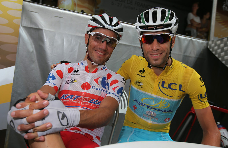 . (L-R) Joaquim Rodrguez of Spain and Team Katusha in the king of the mountains polka dot jersey and Vincenzo Nibali of Italy and the Astana Pro Team in the overall race leader\'s yellow jersey pose for a photo before the start of the fourteenth stage of the 2014 Tour de France, a 177km stage between Grenoble and Risoul, on July 19, 2014 in Grenoble, France.  (Photo by Doug Pensinger/Getty Images)