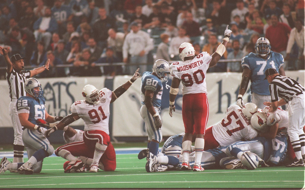 . Lions running back Barry Sanders looks down into a pile of player scrambling for a fourth quarter fumble. The Cardinals recovered the Lions fumble. The Arizonia Cardinals beat the Detroit Lions 17-15 in the Pontiac Silverdome.