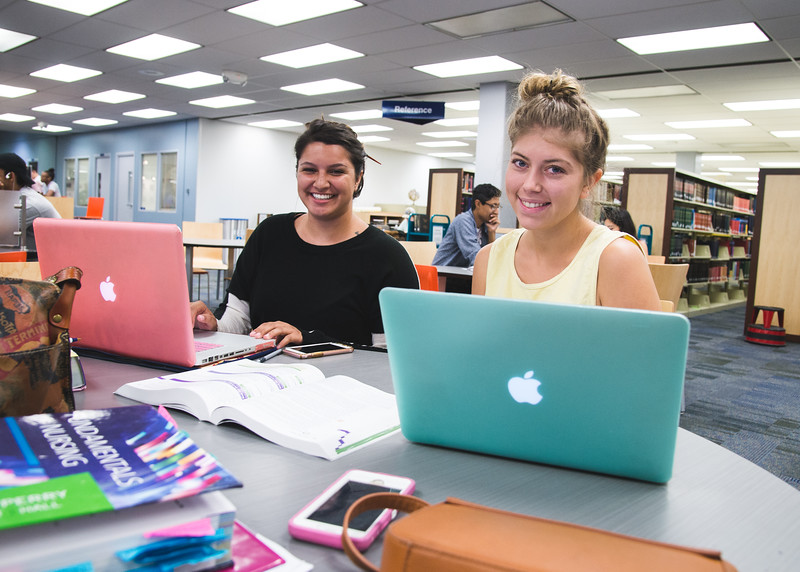 TAMUCC Students Brittany Faucett(Left) and Kim Buitenhuis(Right) study their fundamentals of Nursing in the library.