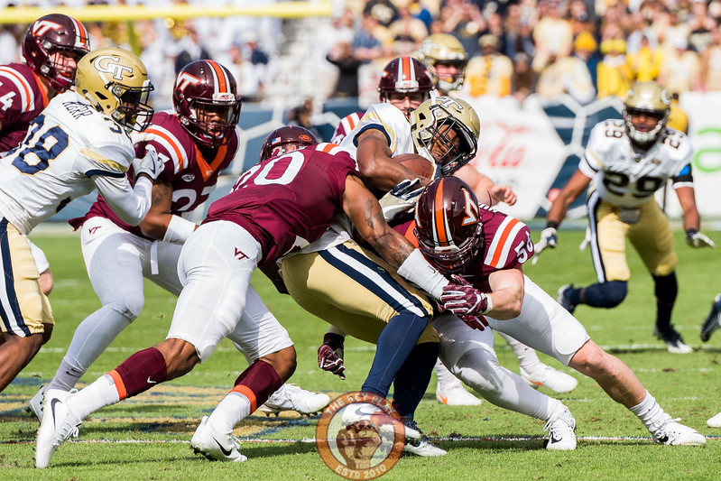 Sean Huelskamp (56) and Deon Newsome (20) combine for a tackle in Saturday's matchup between Virginia Tech and Georgia Tech, Saturday, Nov. 11, 2017. (Special by Cory Hancock)