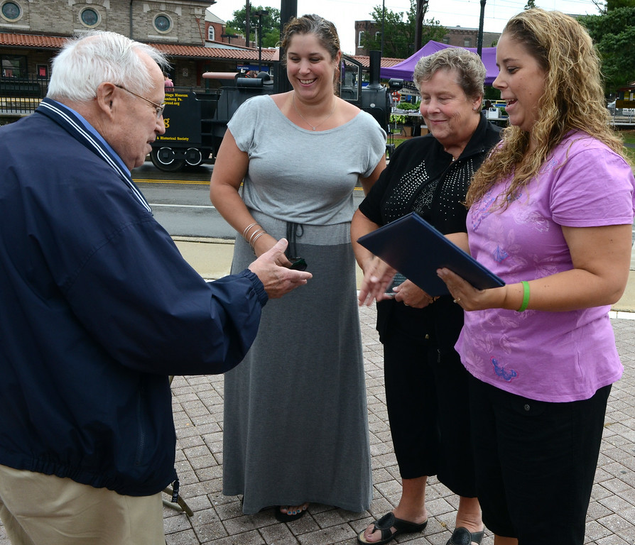 . State Rep. Bob Godshall presents a proclamation to Dorothy Frederick (2nd from R) and her daughters Stephanie (L center) and Karen Diehl after the the Lansdale Borough Lifetime Achievement Award was presented to the late Stephen Frederick during the Lansdale Founders Day  celebration and on Saturday August 23,2014. Photo by Mark C Psoras/The Reporter
