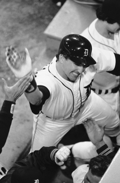. Lance Parrish gets cheers as he enters the dugout after his seventh-inning home run, Sunday, Oct. 14, 1984, Detroit, Mich. His Detroit Tigers beat San Diego, 8-4, and won the World Series. (AP Photo/Rob Kozloff)