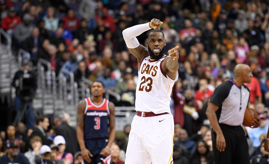 . Cleveland Cavaliers forward LeBron James (23) gestures after he scored during the second half of an NBA basketball game as Washington Wizards guard Bradley Beal (3) looks on, Sunday, Dec. 17, 2017, in Washington. (AP Photo/Nick Wass)
