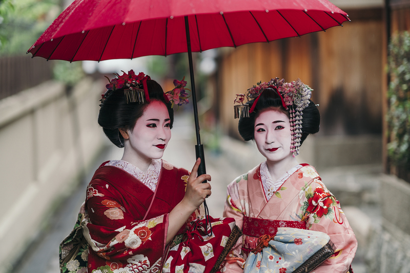 Maiko geisha walking on a street of Gion