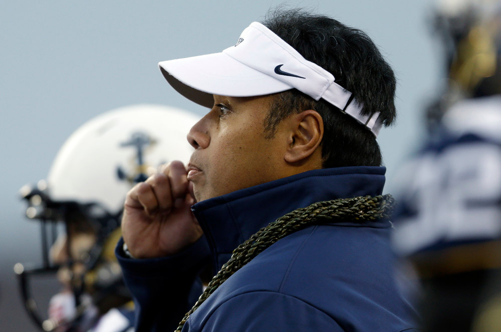 . Navy head coach Ken Niumatalolo meets with players during a timeout in the first half of an NCAA college football game against Army Saturday, Dec. 8, 2012, in Philadelphia. (AP Photo/Matt Rourke)