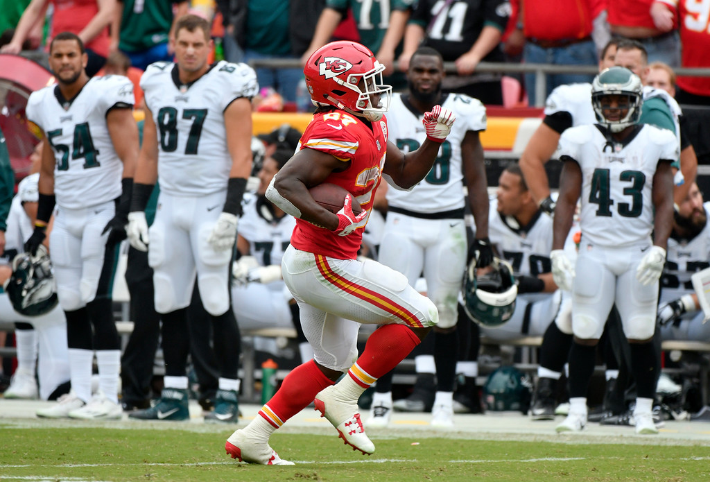 . Kansas City Chiefs running back Kareem Hunt (27) runs past Philadelphia Eagles players for a 53-yard touchdown during the second half of an NFL football game in Kansas City, Mo., Sunday, Sept. 17, 2017. (AP Photo/Ed Zurga)