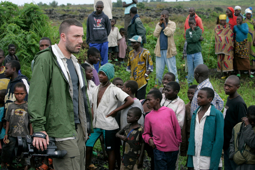 . US actor Ben Affleck walks through a camp for displaced people, Wednesday Nov. 19, 2008, near Kibati just north of Goma in eastern Congo. Affleck is currently in Congo on his fourth trip over the last year, hoping to understand firsthand one of the world\'s worst humanitarian crises of this century. (AP Photo/Karel Prinsloo)