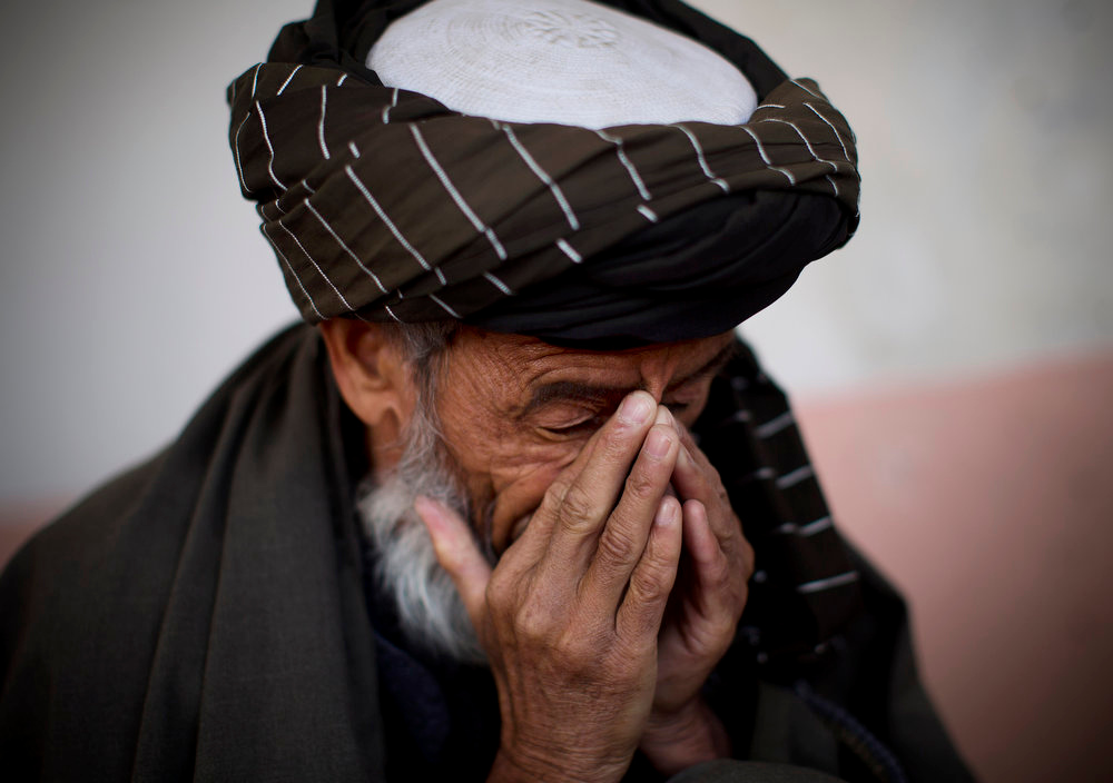 . Hazratullah breaks down as he tells the story of his 21 year old son in U.S. Special Forces custody in Maidan Shahr, Wardak province, Afghanistan, Sunday, March 10, 2013. Afghan President Hamid Karzai, infuriated by villager reports of forced detentions and mass arrests, gave U.S. Special Forces two weeks to vacate Wardak province, located barely 30 kilometers (24 miles) from the Afghan capital of Kabul. The deadline for their withdrawal expired midnight Sunday, March 10, 2013. (AP Photo/Anja Niedringhaus)