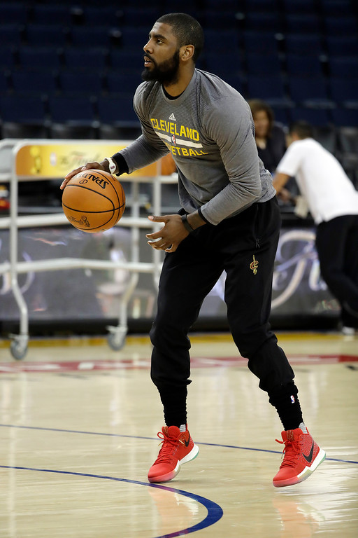 . Cleveland Cavaliers\' Kyrie Irving dribbles during an NBA basketball practice, Wednesday, May 31, 2017, in Oakland, Calif. The Cavaliers face the Golden State Warriors in Game 1 of the NBA Finals on Thursday in Oakland. (AP Photo/Marcio Jose Sanchez)
