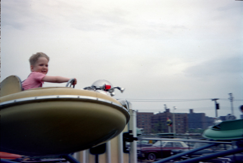 robert on fairyland flying saucer ride.jpg