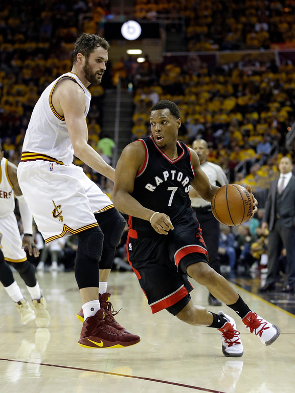. Toronto Raptors\' Kyle Lowry (7) drives past Cleveland Cavaliers\' Kevin Love (0) in the first half in Game 1 of a second-round NBA basketball playoff series, Monday, May 1, 2017, in Cleveland. (AP Photo/Tony Dejak)