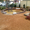 restored and converted sandpit with brick retaining