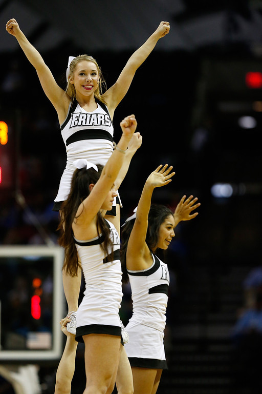 . Cheerleaders from the Providence Friars perform during a first half time out against the North Carolina Tar Heels during the second round of the 2014 NCAA Men\'s Basketball Tournament at AT&T Center on March 21, 2014 in San Antonio, Texas.  (Photo by Tom Pennington/Getty Images)