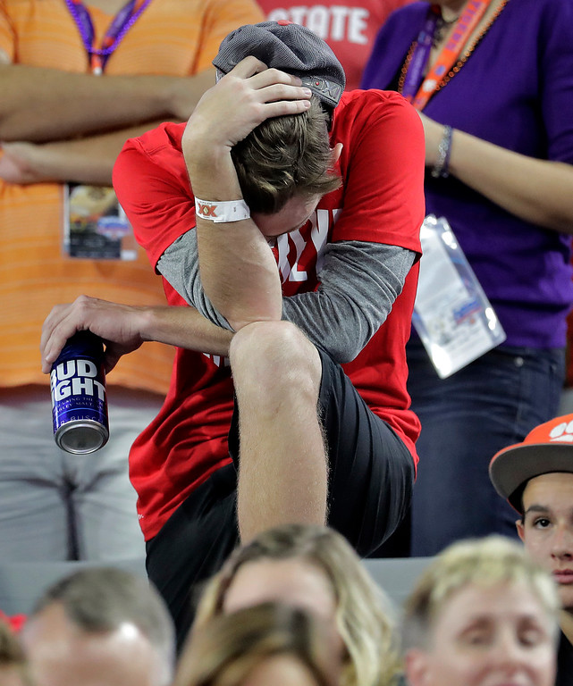 . An Ohio State fan reacts during the second half of the team\'s Fiesta Bowl NCAA college football playoff semifinal against Clemson, Saturday, Dec. 31, 2016, in Glendale, Ariz. Clemson won 31-0 to advance to the BCS championship game against Alabama. (AP Photo/Rick Scuteri)
