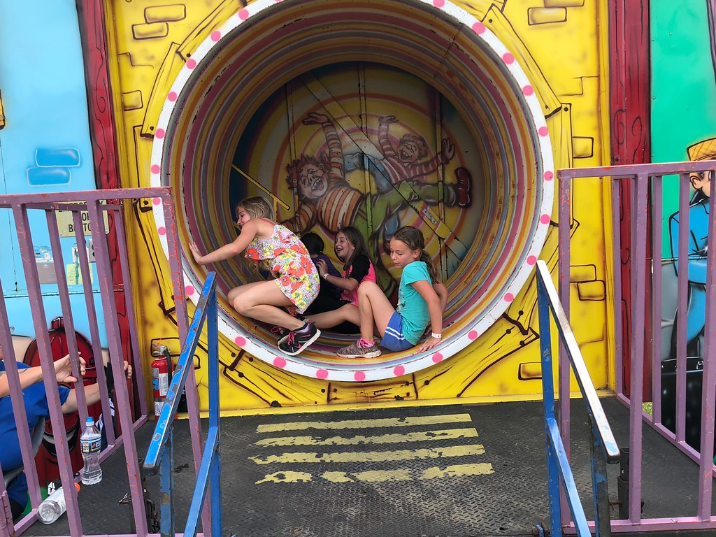 . Tawana Roberts � The News-Herald <br> Kids enjoy the revolving barrel in the Fun House at the 2018 Lake County Fair on July 26.