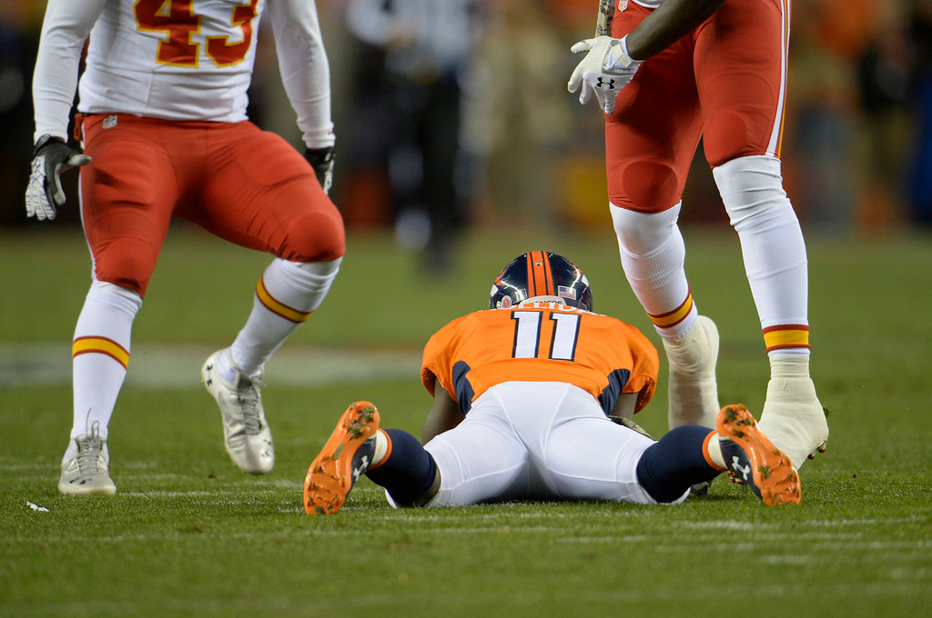 . Denver Broncos wide receiver Trindon Holliday (11) lays down on a bobbled punt catch in the first quarter. The Denver Broncos take on the Kansas City Chiefs at Sports Authority Field at Mile High in Denver on November 17, 2013. (Photo by Joe Amon/The Denver Post)