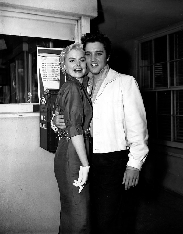 . Elvis Presley poses with co-star Barbara Lang in Los Angeles, Ca., in April 1957.  (AP Photo)