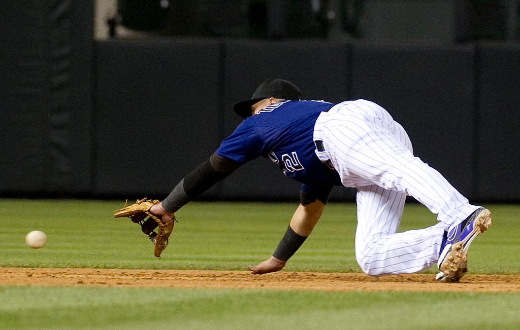 . DENVER, CO - JULY 22:  Colorado Rockies\' #2 Troy Tulowitzki misses a dive during the eighth inning of a Major League Baseball game between the Miami Marlins and the Colorado Rockies on July 22, 2013 at Coors Field. The Miami Marlins defeated the Rockies 3-1. (Photo By Grant Hindsley/The Denver Post)