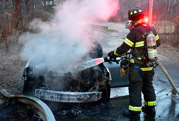 1/30/2020 Mike Orazzi | StaffrBristol firefighters extinguish a car fire on Ambler Road near Birge Pond late Thursday afternoon. No one was injured and the fire was put out quickly.