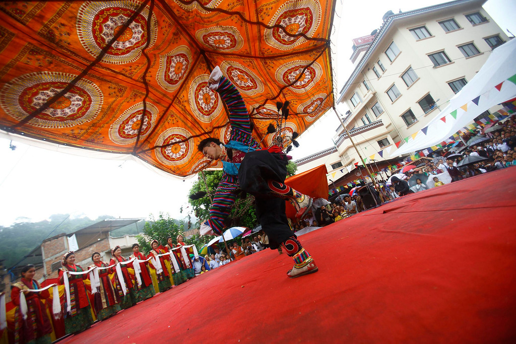 . A Tibetan man dressed in traditional costume performs during celebrations of the 78th birthday of exiled spiritual leader Dalai Lama in Kathmandu July 6, 2013. During last month\'s visit of Chinese State Councilor Yang Jiechi, Chairman of the Interim Election Council Khil Raj Regmi said Nepal is firmly committed to the One-China Policy and reaffirmed its stand that the territory of Nepal will not be allowed to be used for any activities against China. Nepal ceased issuing refugee papers to Tibetans in 1989 and recognizes Tibet to be a part of China. REUTERS/Navesh Chitrakar