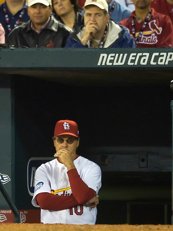 . St. Louis Cardinals manager Tony La Russa watches from the dugout during the seventh inning of Game 3 of the World Series against the Boston Red Sox Tuesday, Oct. 26, 2004, in St. Louis. (AP Photo/Charles Rex Arbogast)