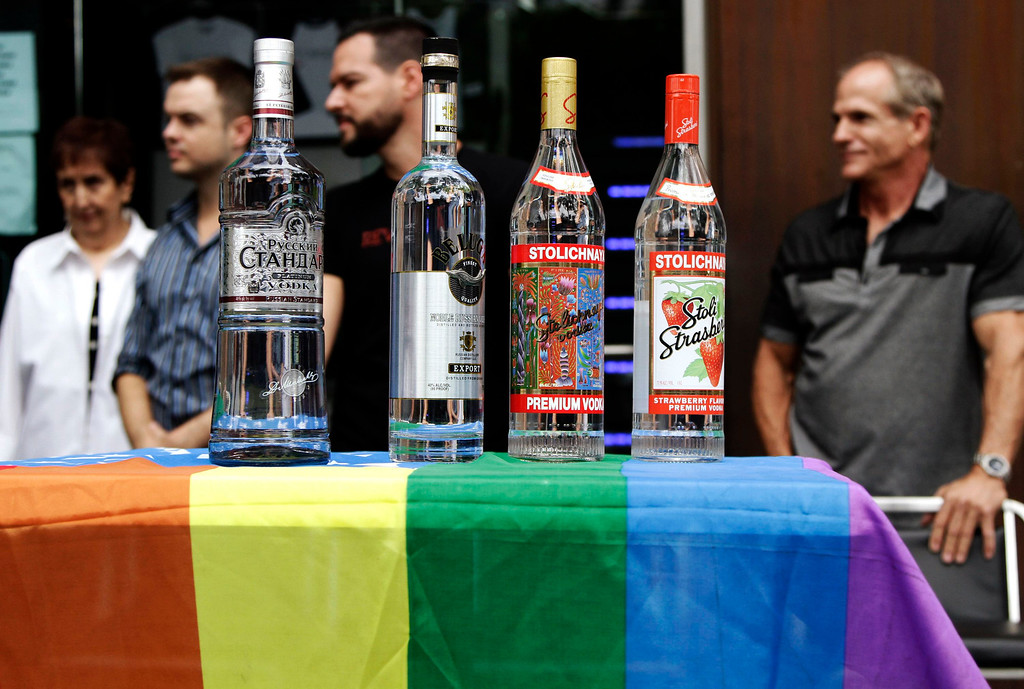 . Bottles of Russian vodka are placed on a lesbian, gay, bisexual, and transgender (LGBT)- themed American flag during a news conference at Micky\'s nightclub in West Hollywood, California August 1, 2013. Bar owners, city officials and members of LGBT organizations participated in the event to announce a boycott of Russian vodkas to protest new laws in Russia targeting homosexuals, according to a news release by the organizers. REUTERS/Jonathan Alcorn