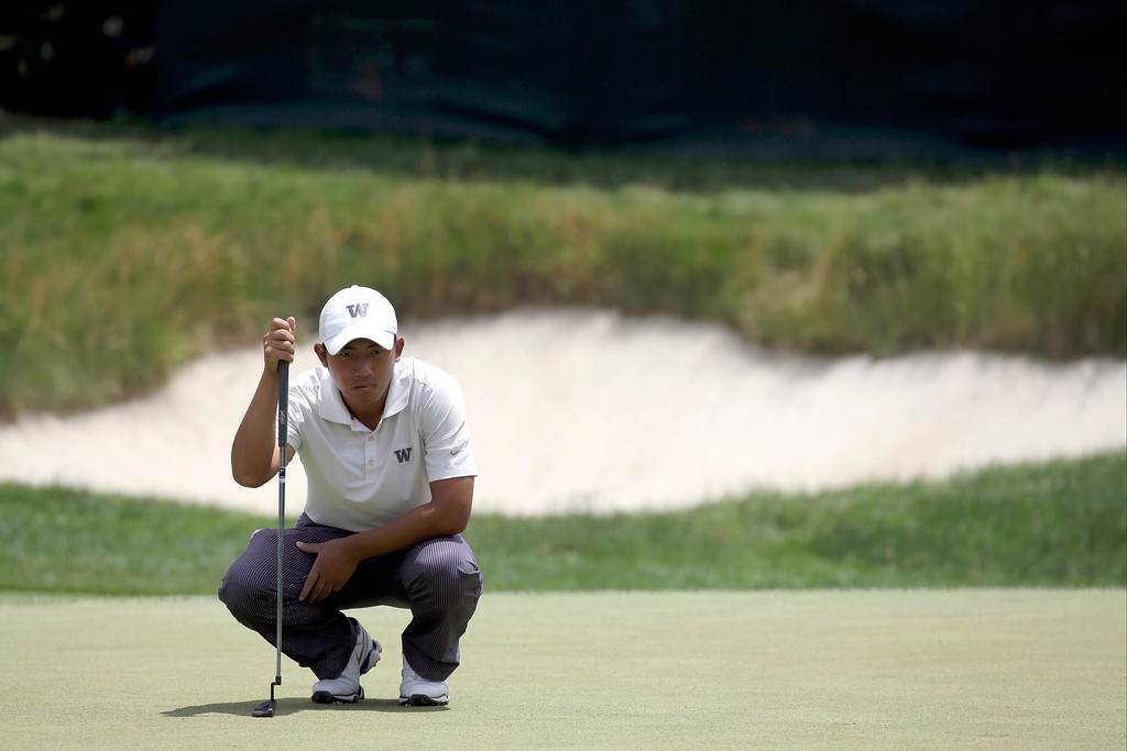 . Cheng-Tsung Pan, of Taiwan, lines up a putt on the first green during the third round of the U.S. Open golf tournament at Merion Golf Club, Saturday, June 15, 2013, in Ardmore, Pa. (AP Photo/Morry Gash)