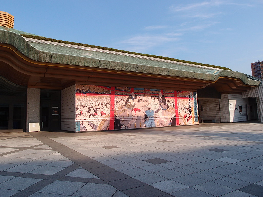 A sumo-themed mural on the building walls.