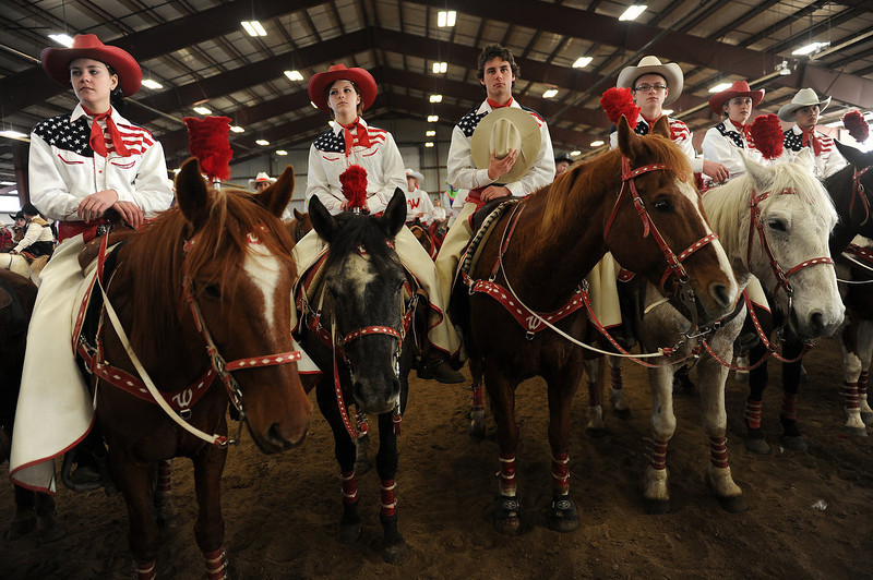 . Lucas Maes, a member of the Varsity Red Team of the Westernaires, holds his hat to his heart during the Easter church service inside the Jefferson County Fairgrounds horse arena on March 31, 2013.  A couple hundred of Jefferson county\'s Westernaires and local horsemen and women took part in the Jefferson County Horseman\'s annual Easter Parade annual that has been taking place in Jefferson County since World War II.  The riders, all on horseback, began their parade near 6th and Kipling, at 10301 West 6th ave,  and finished at the Jefferson County Fairgrounds almost  four miles away.    After the parade a church service, led by Pastor Ed Shirley of Mountain High Christian Church, was held in the horse arena on the fairgrounds. The Westernaires are a horse mounted precision drill organization of Jefferson County that was founded in 1949.  (Photo By Helen H. Richardson/ The Denver Post)