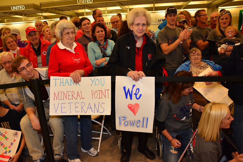 Veterans arrive to the Dane County Regional Airport for a welcome home by several thousand of their closest friends.