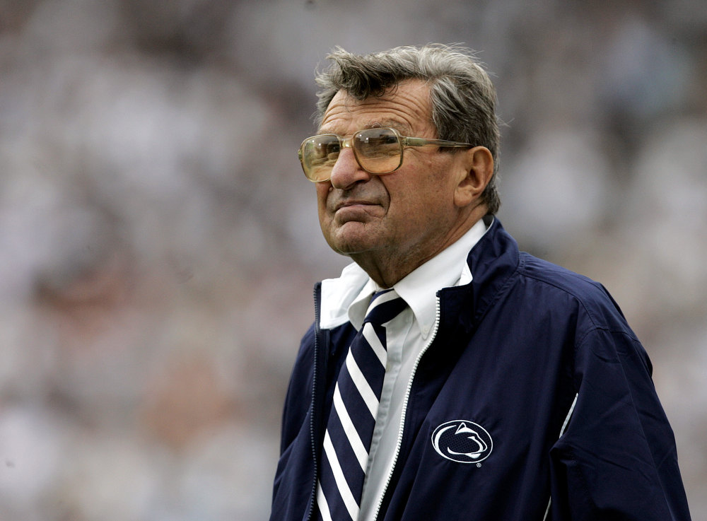 ". In this Sept. 16, 2006 photo, Penn State coach Joe Paterno watches the college football game against Youngstown State from the side lines in State College, Pa. When Penn State opens its football season on Saturday, Sept. 1, 2012, for the first time since 1965, no one with the last name of Paterno will be on the sidelines. Paterno died of cancer in January 2012, just months after losing his job in the wake of the Jerry Sandusky sex abuse scandal. ""Penn State Scandal\"" ranked as Google\'s eighth most searched trending event of 2012. (AP Photo/Carolyn Kaster, File)"