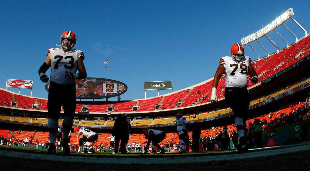 . Cleveland Browns offensive tackle Joe Thomas (73) and John St. Clair (78) warm up prior to the Browns NFL football game against the Kansas City Chiefs Sunday, Dec. 20, 2009, in Kansas City, Mo. (AP Photo/Ed Zurga)