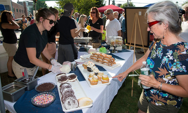 08/08/19 Wesley Bunnell | Staff Haley Procko, L, helps Sandy Destefano with dessert choices at the Paul Gregory's table at the Taste of Southington on Thursday August 8, 2019 at the Barnes Museum.
