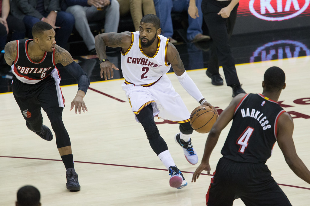 . Michael Johnson - The News-Herald Kyrie Irving of the Cleveland Cavaliers  (2) drives past Damian Lillard (0) during a home game against the Portland Trailblazers on November 23, 2016 at the Quicken Loans Arena.