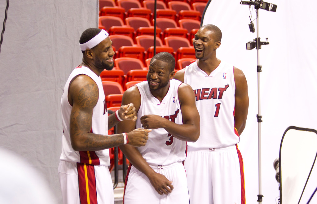 . Miami Heat players LeBron James, left, Dwyane Wade, and Chris Bosh pose for photos during the team\'s media day, Monday, Dec. 12, 2011 in Miami.  (AP Photo/J Pat Carter)