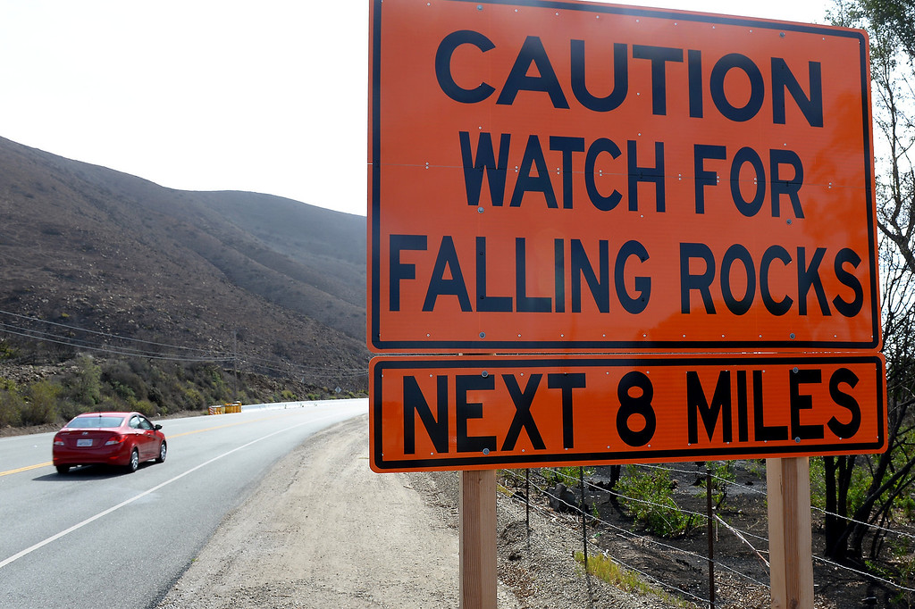 . A sign on Pacific Coast Highway near Pt. Mugu warns of falling rocks along the burnt hillsides from last year\'s Springs Fire, Thursday, February 27, 2014. (Photo by Michael Owen Baker/L.A. Daily News)