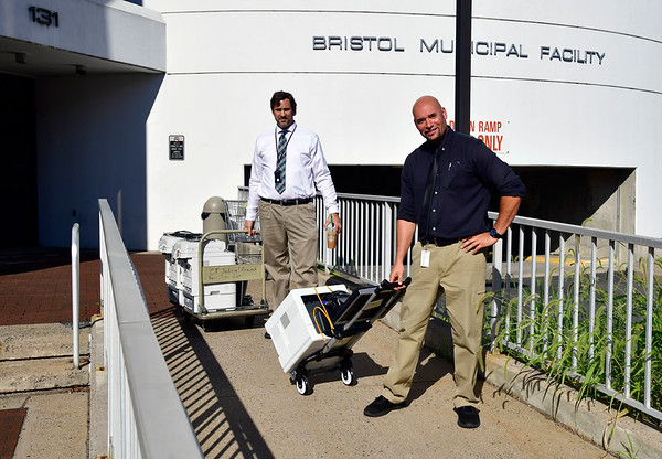 8/30/2019 Mike Orazzi | Staff IT workers Louis Piazza and Rick Snedeker move computer equipment out the Bristol Superior Court on its last day in downtown Bristol.