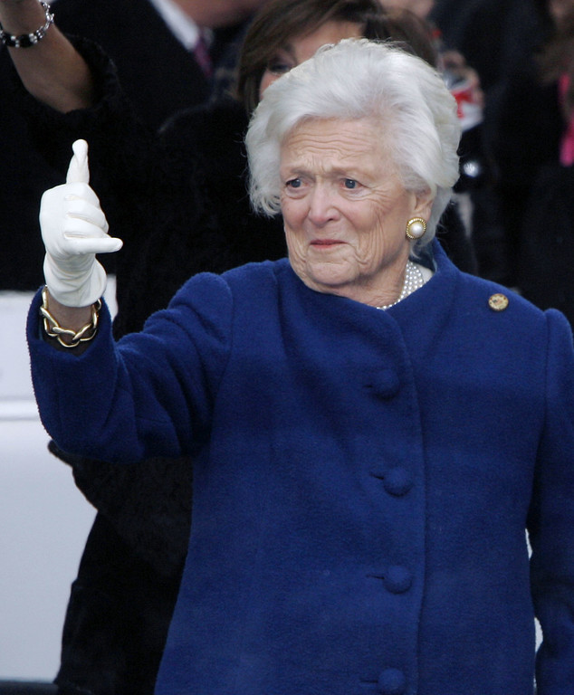 """. Former first lady Barbara Bush gives the \""""Hook \'em Horns\"""" symbol from the reviewing stand during President Bush\'s Inaugural Parade Thursday, Jan. 20, 2005, in Washington. (AP Photo/J. Scott Applewhite)"""