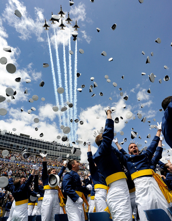 """. Air Force Cadets \""""Dismissed\"""" as the Air Force Thunderbirds fly over the United States Air Force Academy 53rd Graduation, Wednesday May 25th, 2011 at Falcon Stadium.  Andy Cross/The Denver Post"""