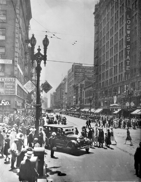View of the corner of West Broadway and South Seventh Street in Los Angeles, ca.1926