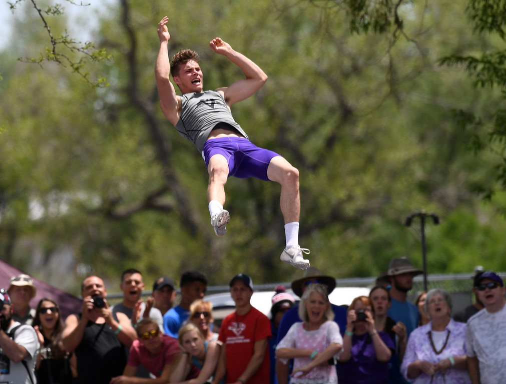. Ramon Salgado, Mountain View, clears 14\' 8 inches during the boys 4A pole vault completion at the Colorado Track and Field State Championships at Jeffco Stadium May 21, 2016. Despite injuring himself on this vault, Salgado won the event with this vault. (Photo by Andy Cross/The Denver Post)