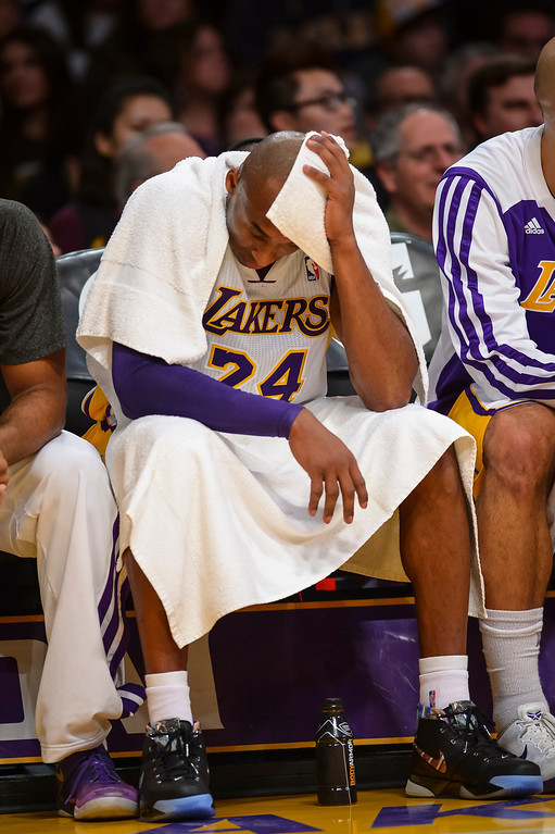 . Lakers� Kobe Bryant takes a break during first half action at Staples Center Sunday, December 8, 2013.   ( Photo by David Crane/Los Angeles Daily News )