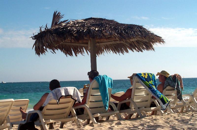 3/15/2004 - Having a beer on the beach - Jon Deutsch, Billy, Chris Webster, JG Ferguson.