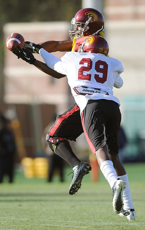 . USC\'s George Farmer tries to catch a pass during spring practice at USC Monday, April 1, 2014. (Andy Holzman/Los Angeles Daily News)