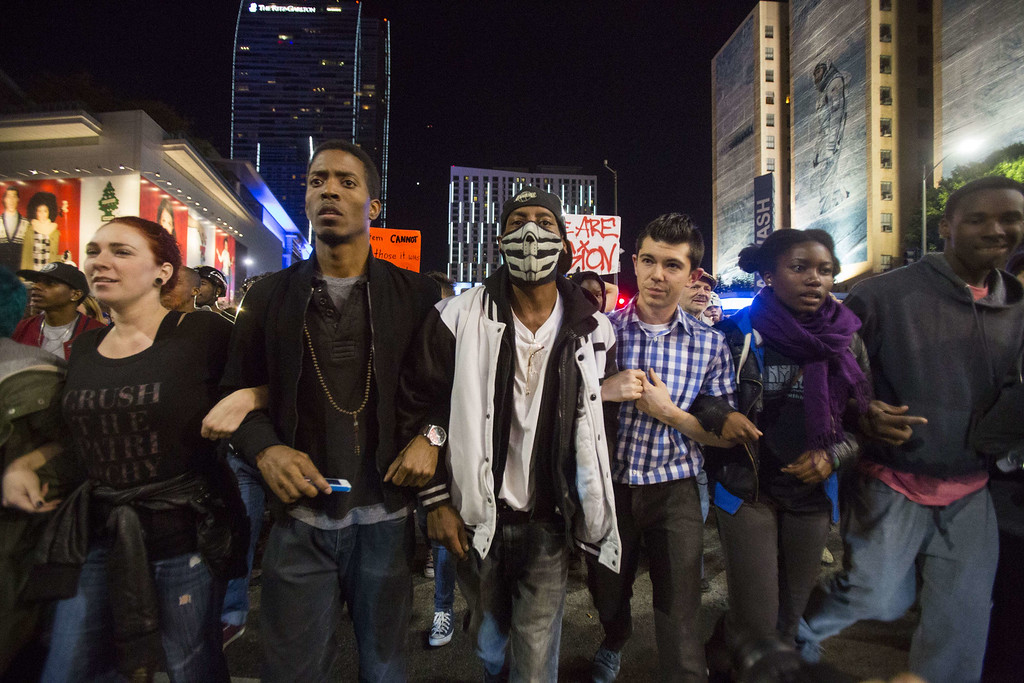 . Demonstrators march on November 26, 2014 in Los Angeles during demonstrations against a decision by a Ferguson, Missouri grand jury to not indict a white police officer in the shooting of black teenager Michael Brown.  Violent protests and looting erupted in the US town of Ferguson for a second day after the grand jury\'s decision. AFP PHOTO / Ringo  CHIU/AFP/Getty Images