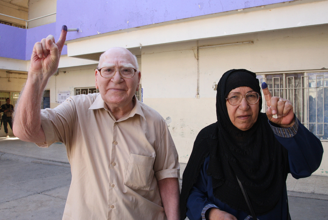 Description of . An elderly couple show their ink-stained fingers after casting their ballot at a polling centre in upscale Mansour Sunni district of Baghdad as Iraqis vote in the country's first parliamentary election since US troops withdrew at on April 30, 2014. Iraqis streamed to voting centres nationwide, amid the worst bloodshed in years, as Prime Minister Nuri al-Maliki seeks reelection. (KHALIL AL-MURSHIDI/AFP/Getty Images)