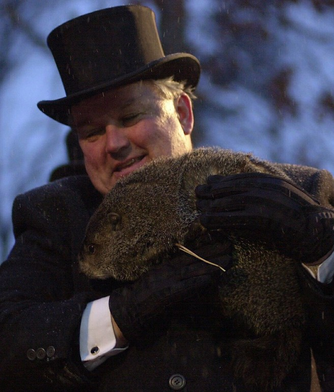 . Weather prognosticating groundhog Punxsutawney Phil is held by handler Bill Deeley Friday, Feb. 2, 2001, in Punxsutawney, Pa.  Punxsutawney Phil saw his shadow on Gobbler\'s Knob Friday morning thereby signaling six more weeks of winter weather. (AP  Photo/Gene J. Puskar)