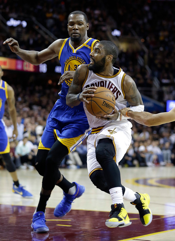 . Cleveland Cavaliers guard Kyrie Irving drives on Golden State Warriors forward Kevin Durant (35) during the second half of Game 3 of basketball\'s NBA Finals in Cleveland, Wednesday, June 7, 2017. Golden State won 118-113. (AP Photo/Tony Dejak)